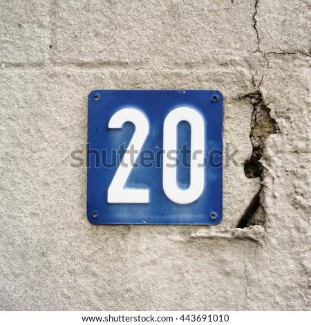 house number twenty embossed in a metal plate - stock photo
