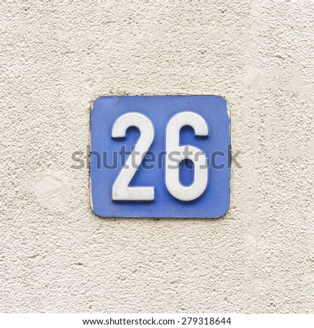 house number twenty six, white numerals on a blue background - stock photo