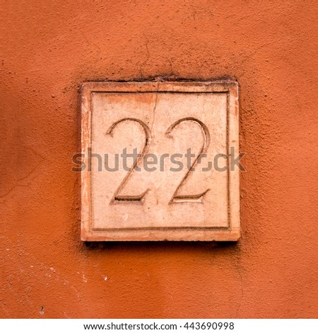 House number twenty two engraved in natural stone. - stock photo