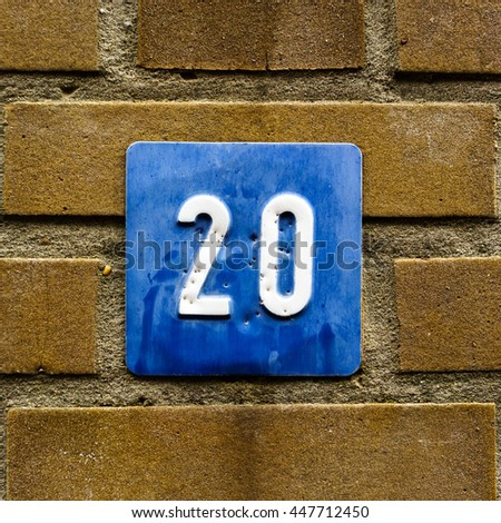 House number twenty. White numerals on a blue background - stock photo