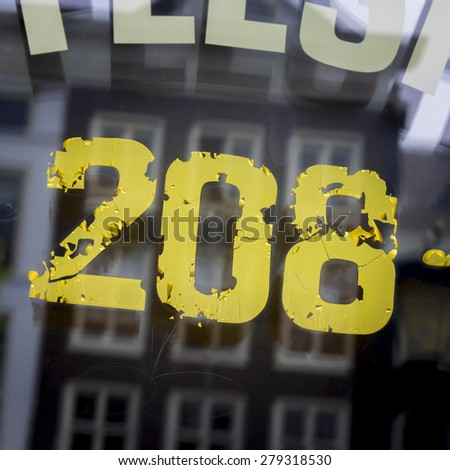 house number two hundred and eight, on a reflective window - stock photo