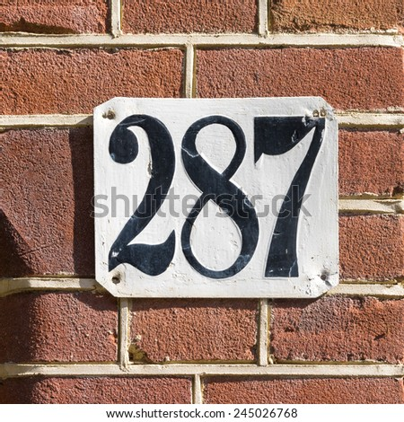 house number two hundred and eighty seven - stock photo
