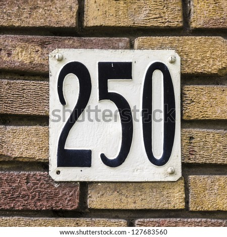 House number two hundred and fifty. Black lettering on a white background - stock photo