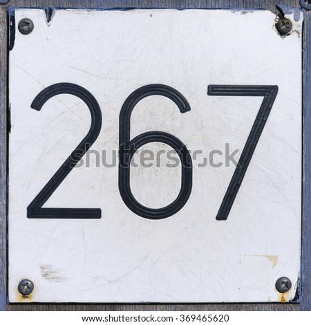 house number two hundred and sixty seven, engraved i a white formica plate. - stock photo