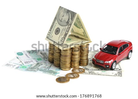 House of banknotes, coins and the car on a white background - stock photo