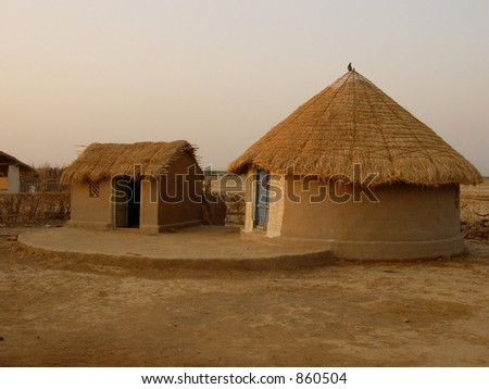 house of different shapes in an indian village - stock photo