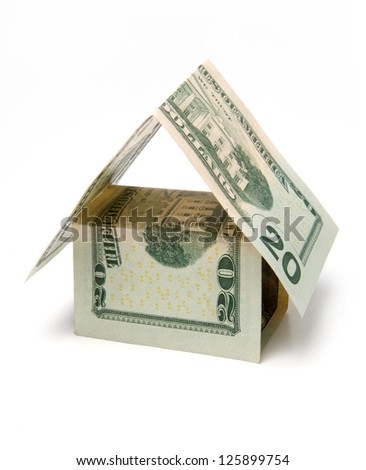 house of dollar bills - a symbol of the mortgage lending - stock photo