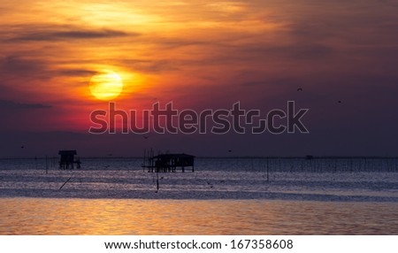 House of fishermen on the sea, sunset in Thailand.