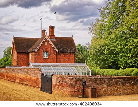 House of gardener and Kitchen garden in Audley End House in Essex in the United Kingdom. It is a medieval county house. Now it is under protection of the English Heritage. - stock photo