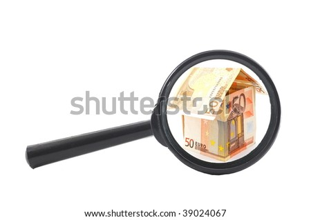 house of money and magnifying glass showing real estate concept - stock photo