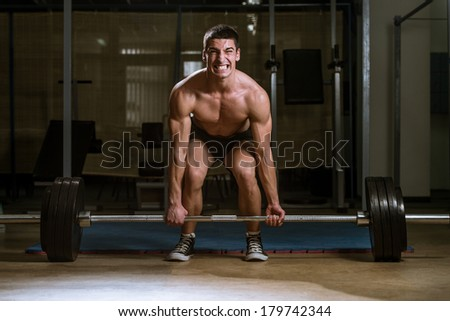 House of Pain - Muscular Men Lifting Deadlift In The Gym - stock photo