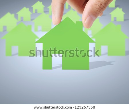 house of paper in hand businessmen - stock photo