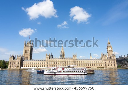 House of Parliament with Big Ben tower with touristic boats in foreground, London - stock photo