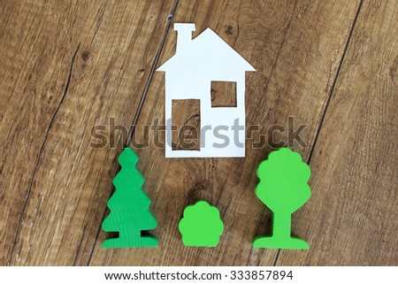house of the green fence. house for green fence from a bush, the concept of landscape design - stock photo