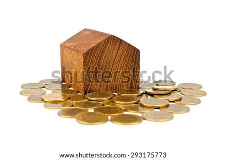 House on a heap of gold coins isolated on white background.