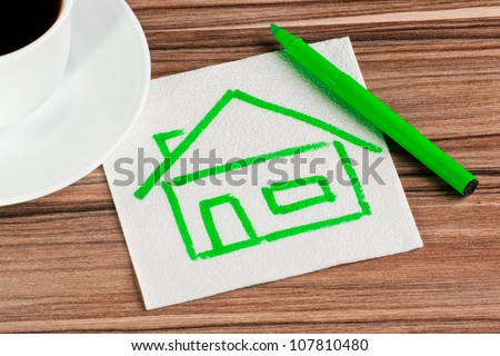 House on a napkin and cup of coffee - stock photo