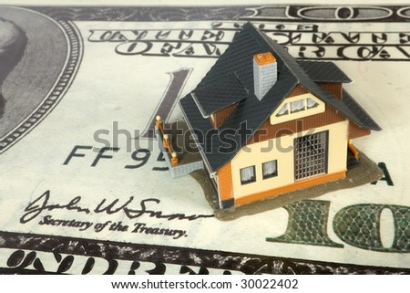 house on big dollar banknotes. - stock photo