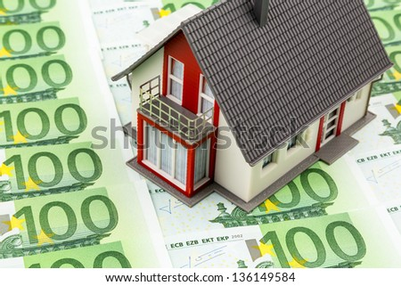 house on bills, symbolic photo for home purchase, financing, building society - stock photo