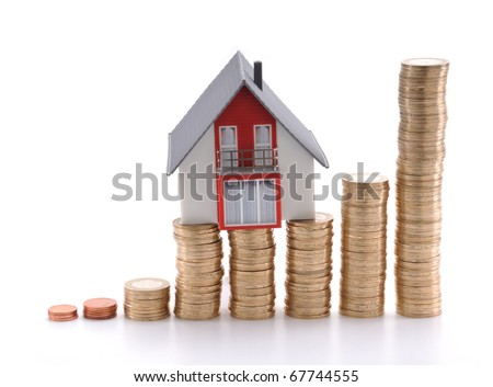 House on coins isolated on white background, mortgage concept.