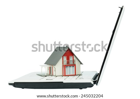 house on computertastaur, symbolic photo for real estate and housing market in the internet - stock photo