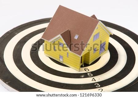 House on dartboard - stock photo