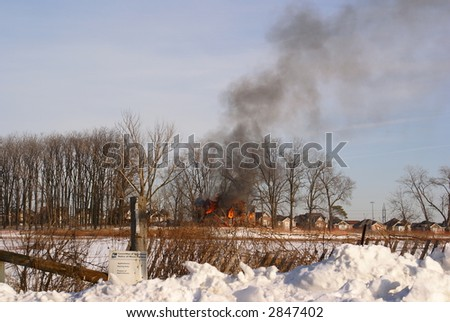house on fire - stock photo