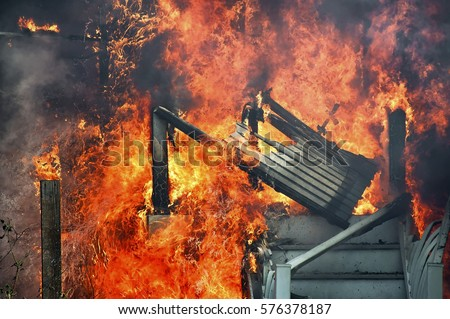 house on fire, fully involved, stairs melting and building collapsing from heat