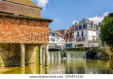 House on stilts in the French town of Salies de Bearn. - stock photo