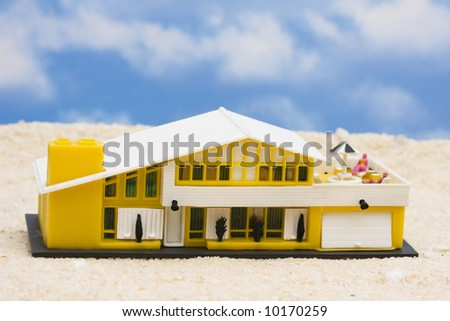 House on the beach with sand and sky background - stock photo