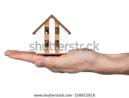 House on the hand - stock photo