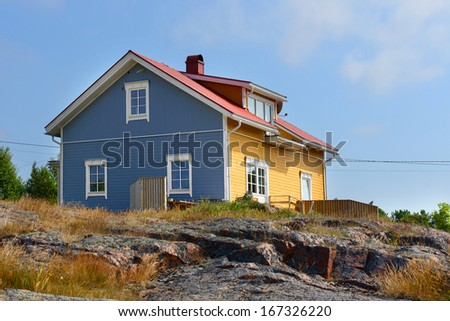 House on the rocky shore. Aland Islands, Finland - stock photo
