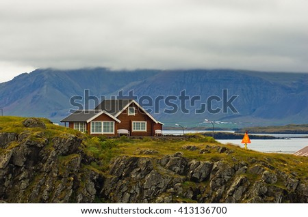 House on top of a cliff in west Icelandic fjord near Stykkisholmur harbor, Iceland - stock photo
