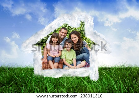House outline in clouds against scenic landscape - stock photo