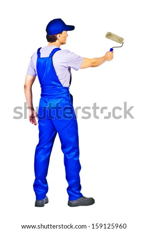 house painter in blue uniform  is painting invisible wall, view from behind Isolated on white background  - stock photo