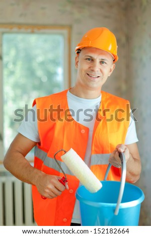 house painters with paint roller is ready for operation - stock photo
