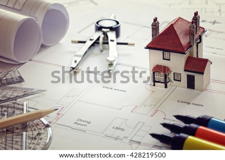 House plan blueprint and model house concept for new house design or home improvement - stock photo