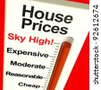 House Prices High Monitor Showing Expensive Mortgage Cost - stock photo