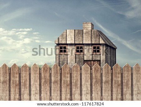 House Protected by the Fence - stock photo