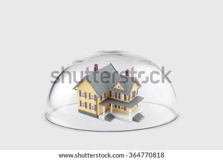 House protected under a glass dome  - stock photo