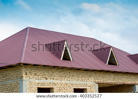 house, red roof and blue sky