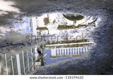 House reflected in a puddle - stock photo