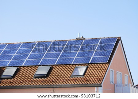 House roof covered with solar panels - stock photo