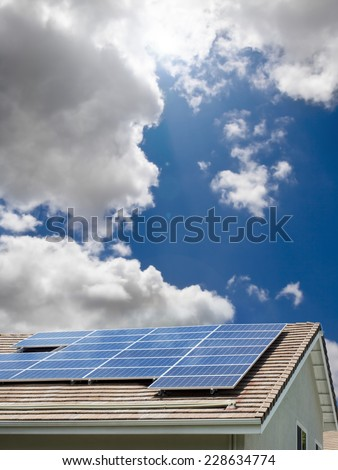 House, roof with solar panels - stock photo