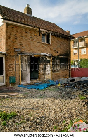 house ruin after fire. burned down property in urban area - stock photo