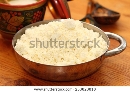 house rural cottage cheese in a metal bowl