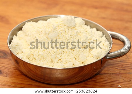 house rural cottage cheese in a metal bowl - stock photo