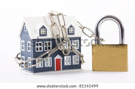 House secured with chain and padlock on a white background