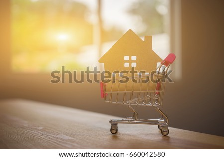First time home buyer stock images royalty free images vectors house shape inside of the shopping cart how to become a first time homeowner ccuart Image collections