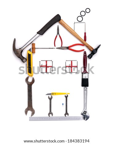 House shape made from construction tools isolated on white background - stock photo