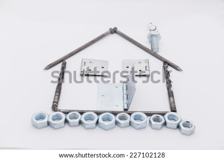 House shaped frame made of metal parts - stock photo